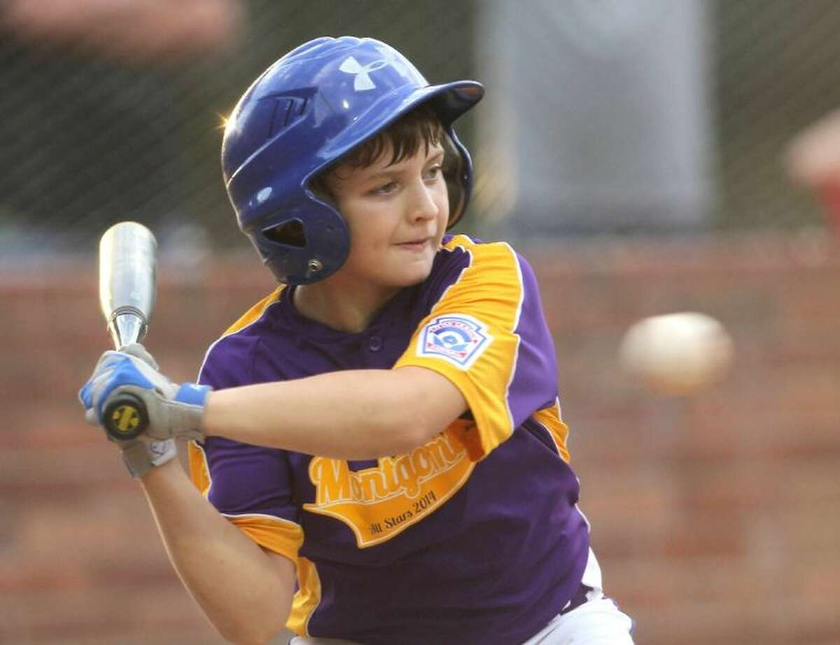 The Montgomery All-Stars' Brandon Nicholson fields a ball during the second round of the District 28 10-11 year old tournament at ORWALL baseball fields Thursday. To view or purchase this photo and others like it, visit HCNpics.com.