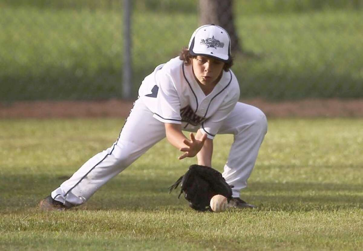ORWALL National League's Charlie Mazur fields a ground ball during the second round of the District 28 10-11 year old tournament at ORWALL baseball fields Thursday. To view or purchase this photo and others like it, visit HCNpics.com.