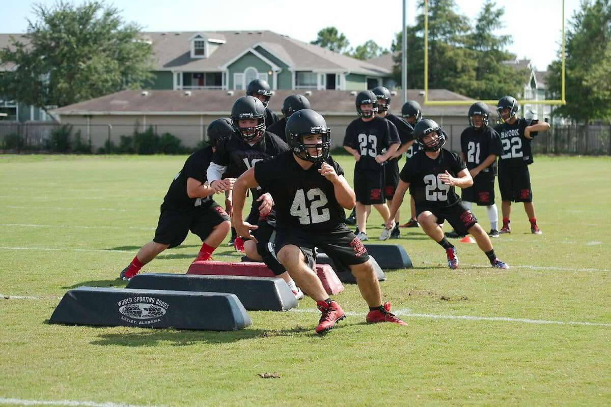 Clear Brook defensive players, running through drills this August, hope to progress quickly in a new scheme this fall.