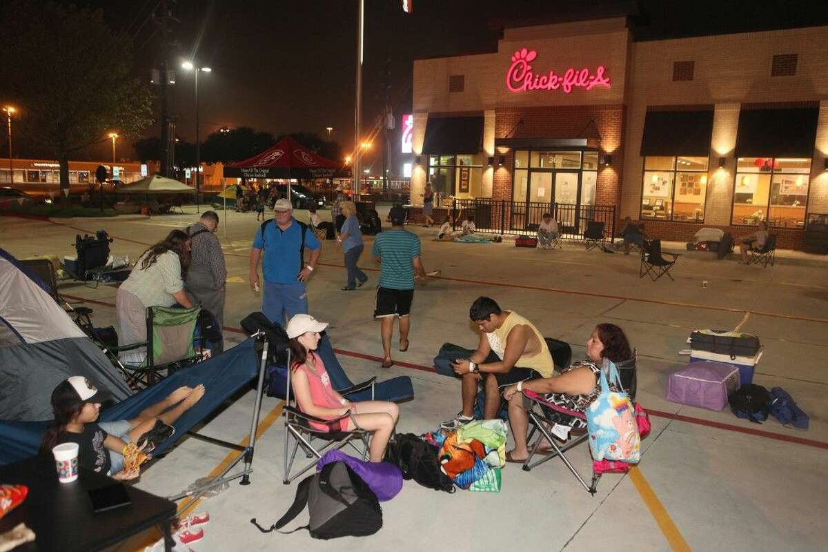 Local customers camp out in the parking lot to become the first 100 in line to win free Chick-fil-A for a year at the newly rebuilt Chick-fil-A at Mason Road in Katy , Texas on Thursday, Oct. 2, 2014. Click the gallery for things you probably didn't know about Chick-fil-A.