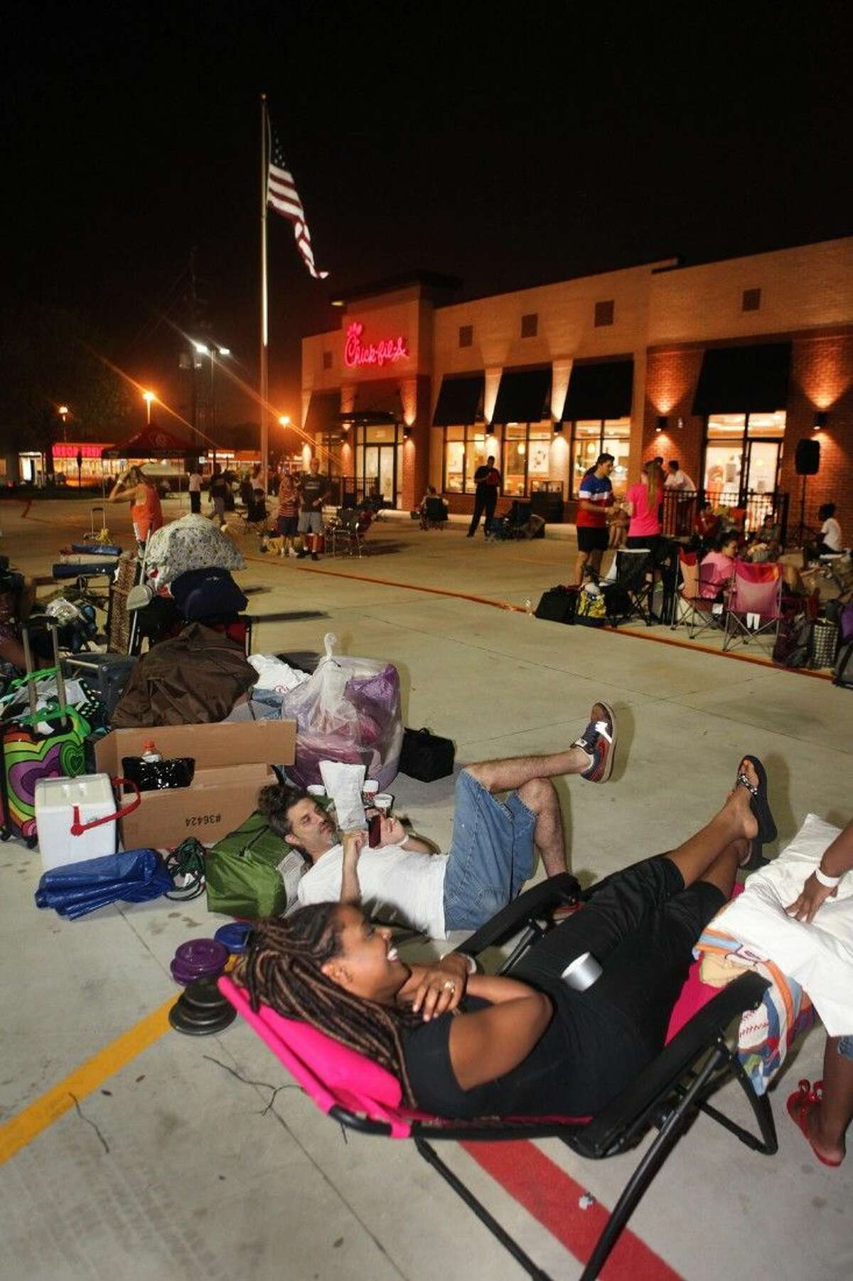 Tory and Rob Taylor of Houston camp out in the parking lot waiting for the newly rebuilt Chick-fil-A at Mason Road in Katy to open.