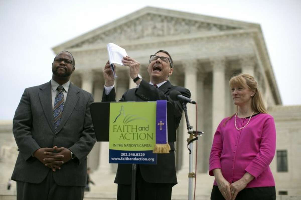Reverend Dr. Rob Schenck, of Faith and Action, center, speaks in front of the Supreme Court with Raymond Moore, left, and Patty Bills, both also of Faith and Action, during a news conference, Monday, May 5, 2014, in Washington, in favor of the ruling by the court's conservative majority that was a victory for the town of Greece, N.Y., outside of Rochester. A narrowly divided Supreme Court upheld decidedly Christian prayers at the start of local council meetings on Monday, declaring them in line with long national traditions though the country has grown more religiously diverse.