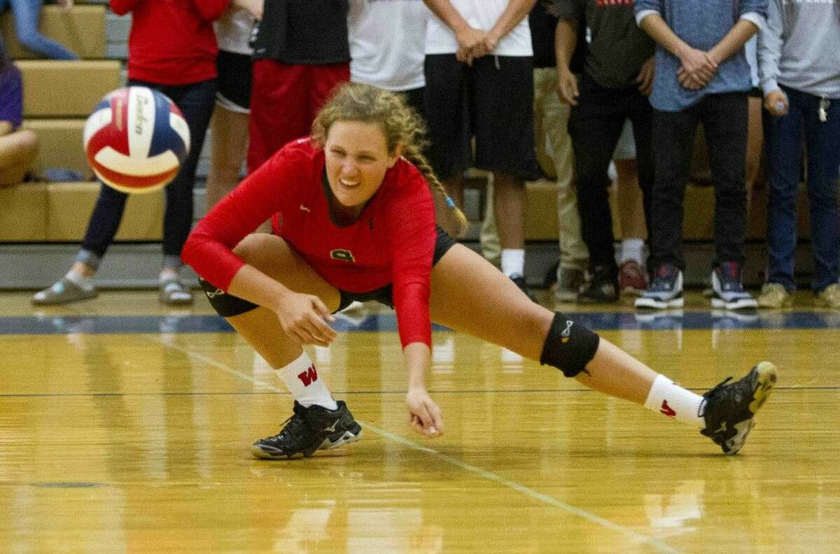 The Woodlands Grey Kennedy goes for a dig during a volleyball game Tuesday. To view or purchase this photo and others like it, visit HCNpics.com.