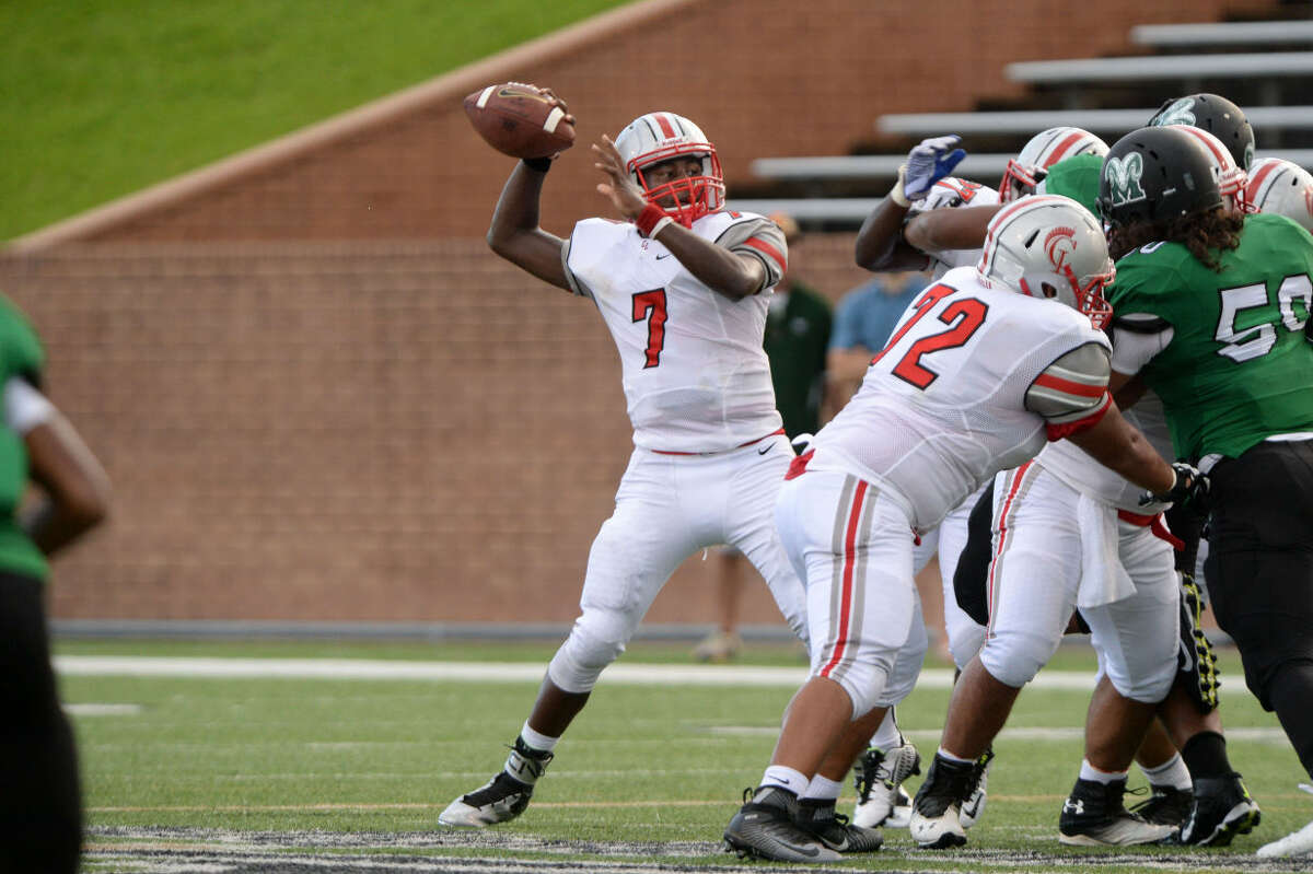 Cy Lakes quarterback Le'teddrian Soloman, with the help of blockers including Dominique Pagayon (72), passed for five touchdowns and ran for two in a 68-38 victory against Mayde Creek, Sept. 3 at Rhodes Stadium. To view or purchase this photo and others like it, visit HCNpics.com