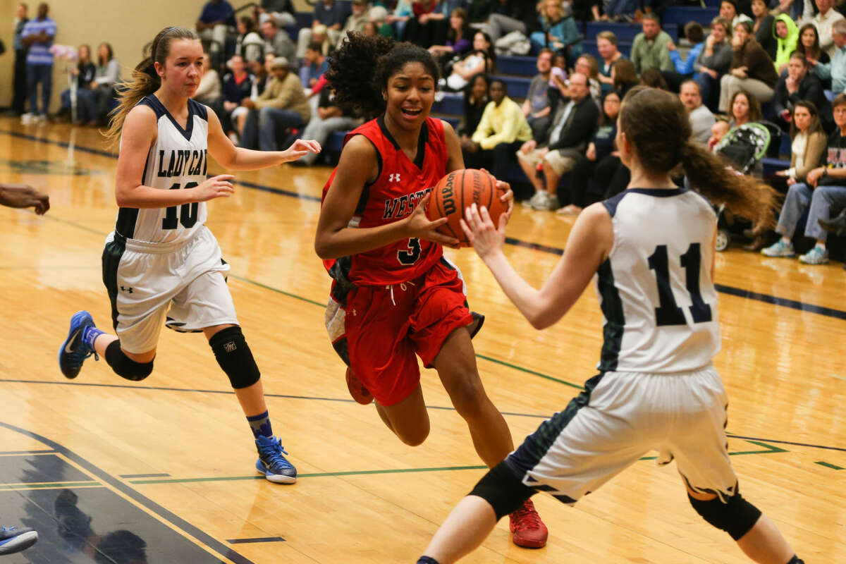 Westfield's Jamira Slade (3) tries to get past College Park defenders during the high school girls basketball game on Tuesday, Dec. 9, 2014, at College Park High School.