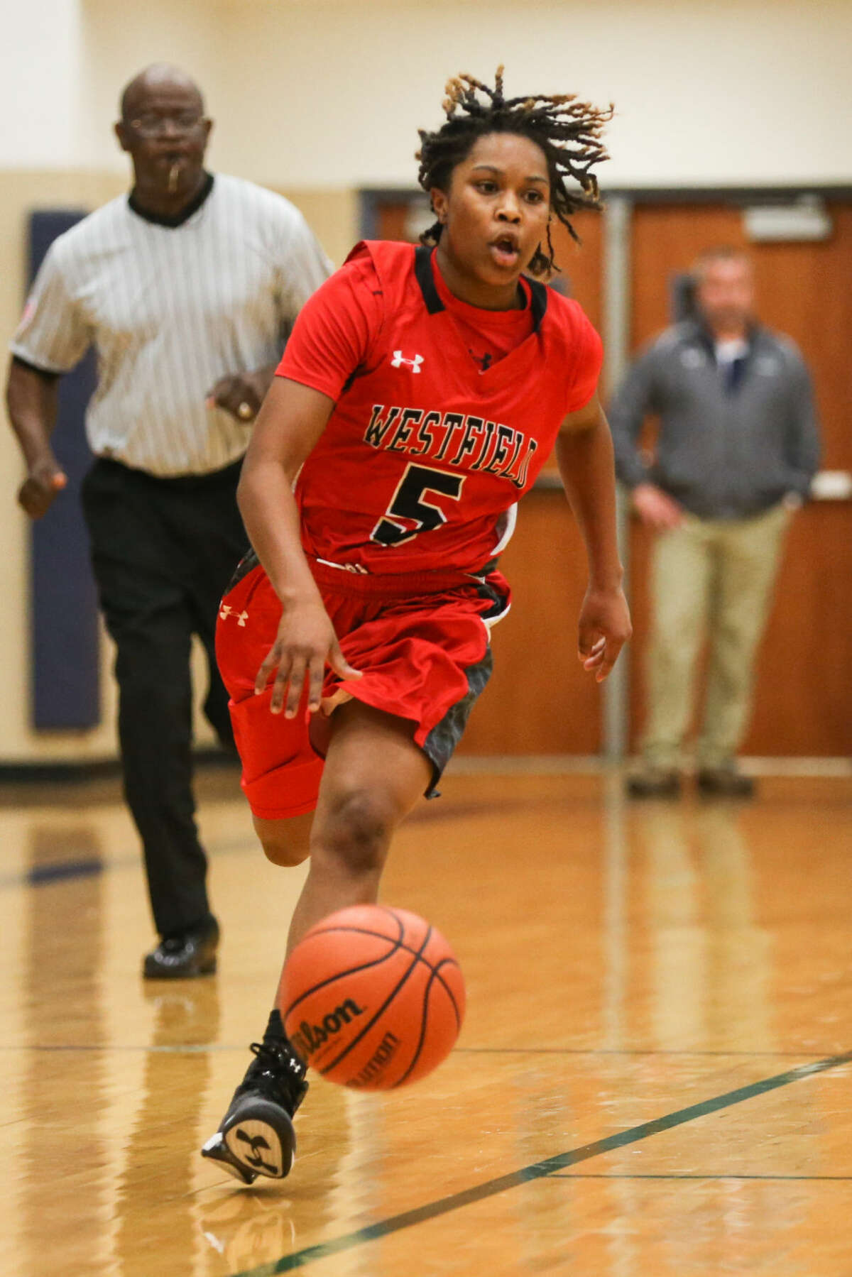 Westfield's Faitress Shaw (5) tries to get past College Park defenders during the high school girls basketball game on Tuesday, Dec. 9, 2014, at College Park High School.