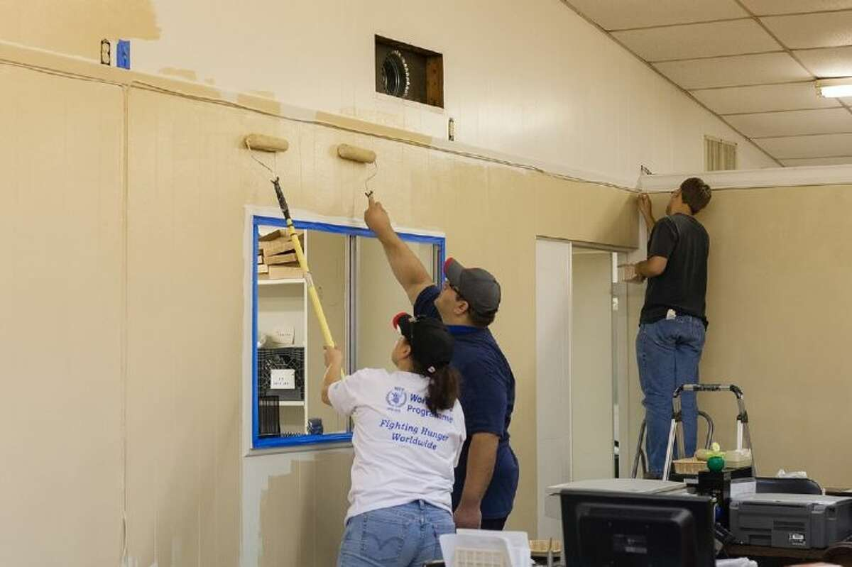 3M Company employees volunteered to paint several rooms at Brazosport Cares in Freeport as part of United Way of Brazoria County's Day of Action.