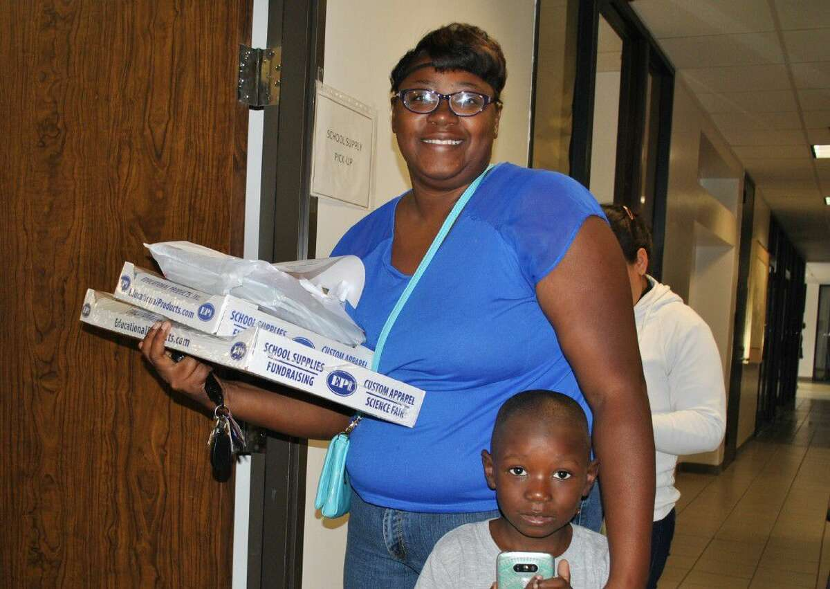 Cynthia Ross and her 4-year-old Noah during Northwest Assistance Ministries' Back to School delivery day.