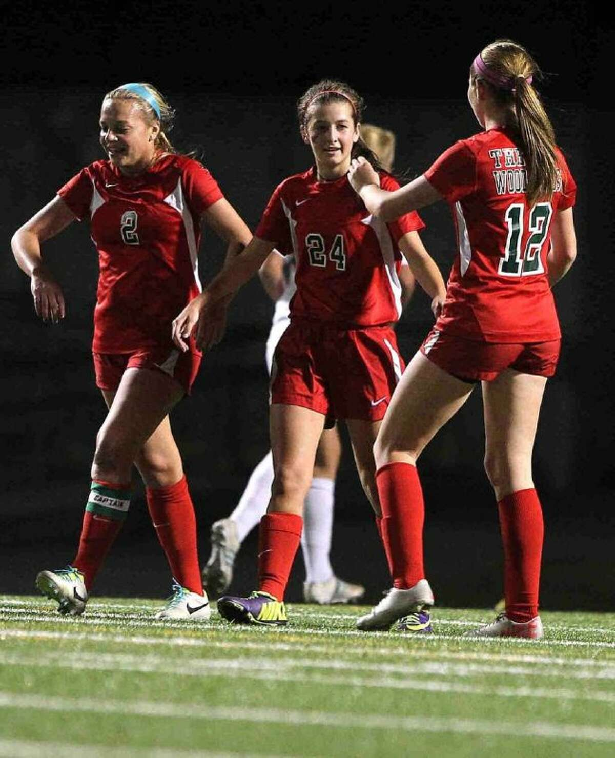 The Woodlands' Kylie Dodson (24) ` celebrates with teammates after scoring a goal in the first half of Friday's match against Conroe at Buddy Moorhead Memorial Stadium. To view or purchase this photo and others like it, visit HCNpics.com.