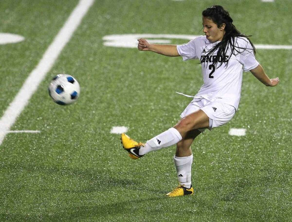 Conroe's Nayari Arquieta kicks the ball downfield during Friday's match against The Woodlands at Buddy Moorhead Memorial Stadium. To view or purchase this photo and others like it, visit HCNpics.com.