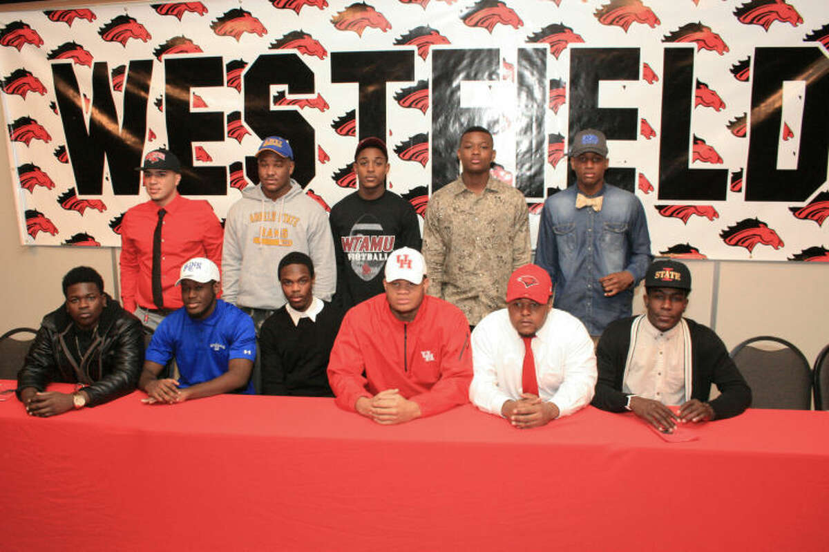 Westfield High School football players gather to sign letters of intent to play college ball during a ceremony at Westfield High School. First row, from left, are Michael Jackson, Kilgore Junior College; Paul Leblanc, Blinn Junior College; Tevin Lewis, Tyler Junior College; Marcus Oliver, University of Houston; Adrian Parker, Incarnate Word University; and Brian Peavy, Iowa State University. Second row, from left, are Ramon Coto, Incarnate Word University; Dekwan Dukes, Angelo State University; Cortland Greenwood, West Texas A&M University; Michael Price, Kilgore Junior College; and Donovan Thompson, Angelo State University. Westfield's head coach is Corby Meekins.