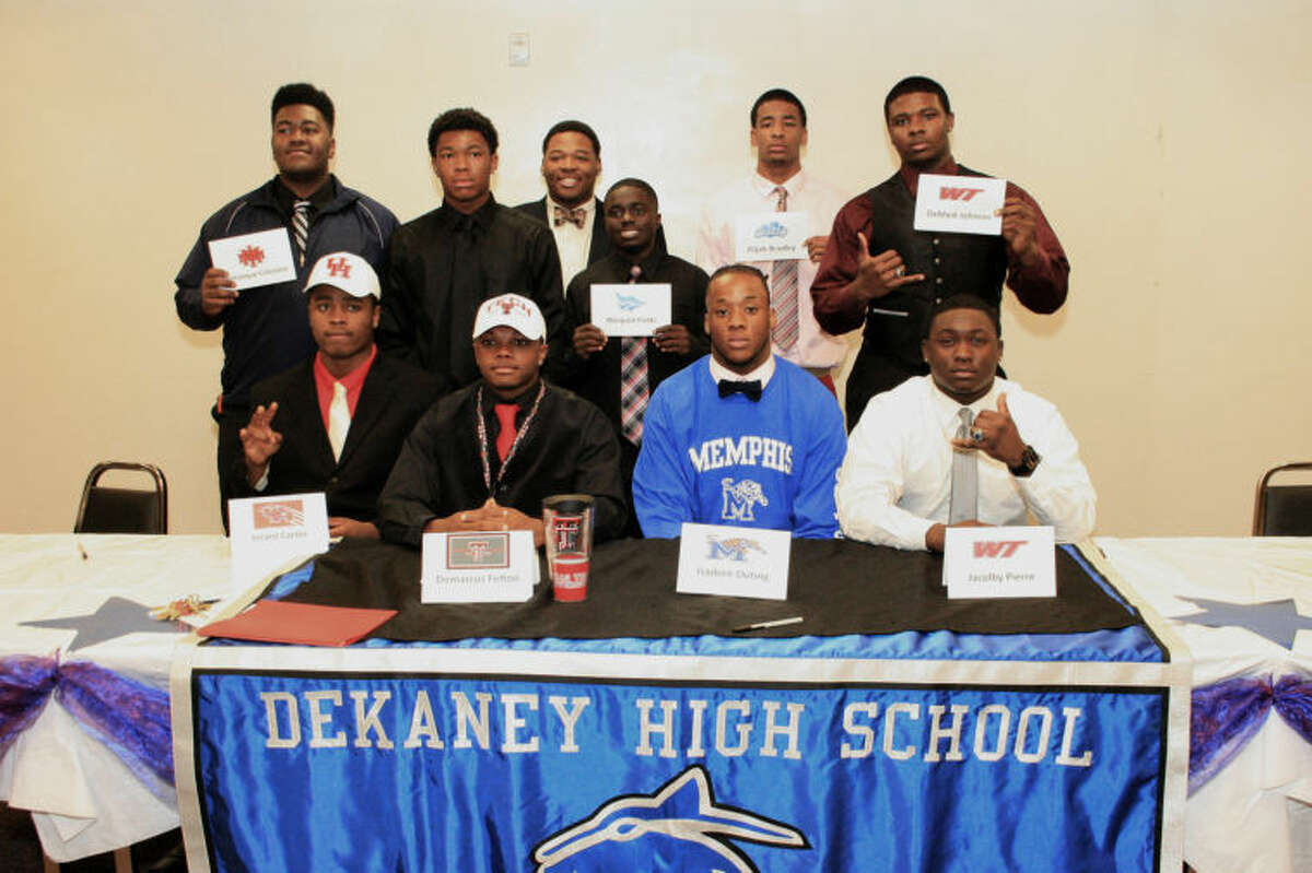 Ten Dekaney High School football players signed letters of intent to play college ball during a ceremony at their school. First row, from left, are Jerard Carter, University of Houston; Demarcus Felton, Texas Tech; Isadore Outing, University of Memphis; and Ja'Colby Pierre, West Texas A&M. Second row, from left, are Domonique Celestine, New Mexico Military Institute; Jerrick Bledsoe, Lane College; Dazzmond Walker, Cisco Junior College; Marquist Fields, Tabor College; Elijah Bradley, Cisco Junior College; and Demark Johnson, West Texas A&M. Dekaney High School's head coach is Anthony Williams.