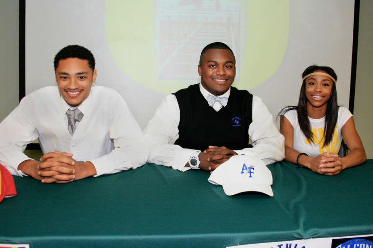 Three Spring High School seniors signed letters of intent for college football or track during the school's national signing day ceremony. From left, are Darius Lee Campbell, Iowa State; Paul Love, United States Air Force Academy; and Alaysh'A Johnson, University of Oregon.