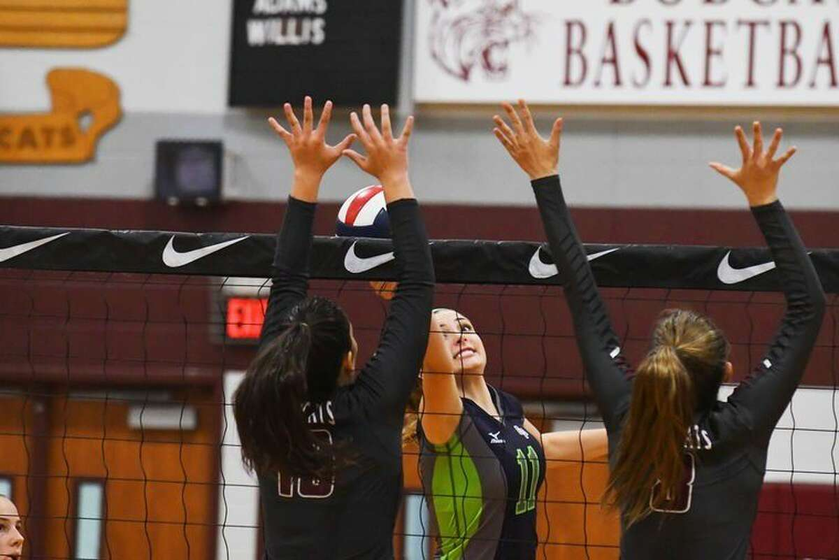 Cy-Fair senior Alex Cormack and junior Sofia Black go up to block a tip from College Park's Audrey Penn. Cy-Fair is a young team, and Cormack is one of only two seniors on the squad.