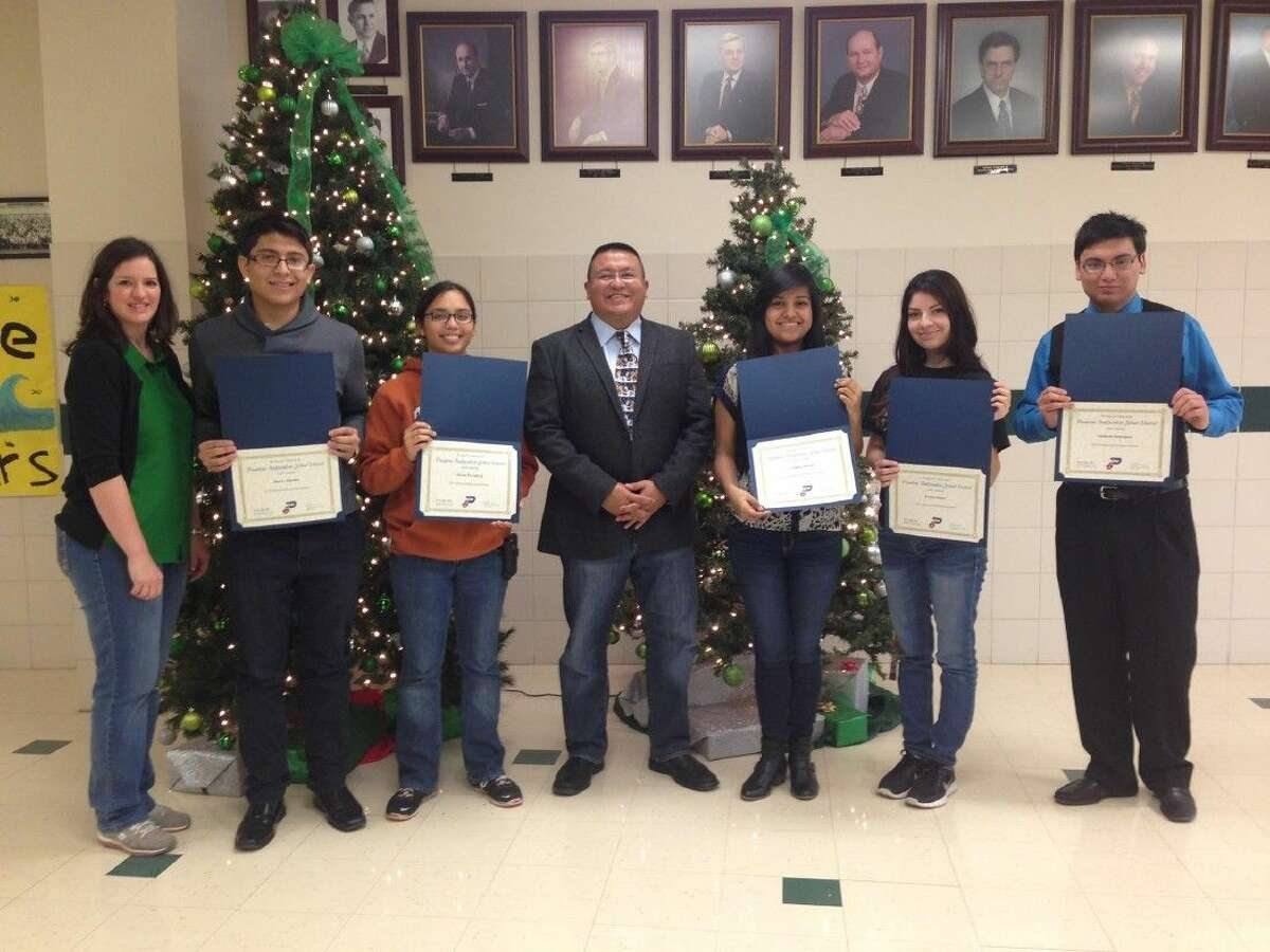 Pictured from l to r: Nicole Shuler, PHS Assistant Principal; student Jose Sanchez; student Alexus Garcia; Joe Saavedra, PHS Principal; student Cynthia Moreno; student Evelyn Ibanez and student Abelardo Rodriguez.