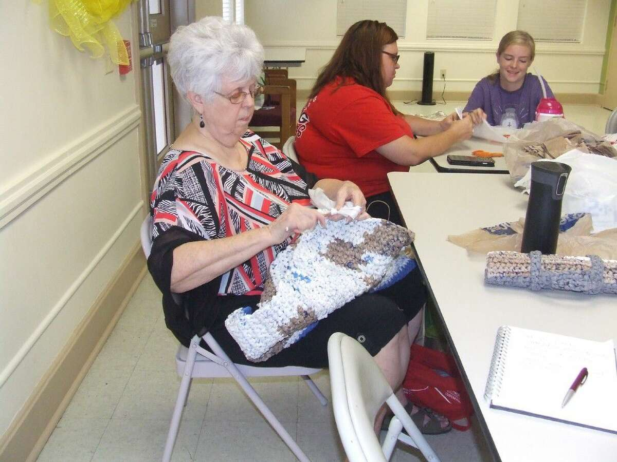 LaVerne Meade knits plastic grocery bags into a mat for the homeless at the Tomball Community Center on Aug. 16.