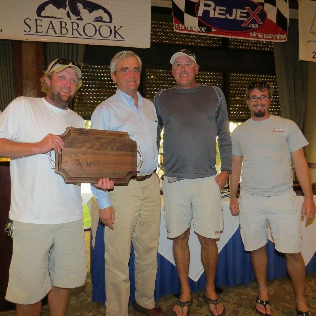 Lakewood Yacht Club racer Casey Lambert (far left) placed first in the competitive J/22 fleet for the 5th Annual J/Fest Southwest Regatta held over the weekend of Nov. 1-2. He is pictured with J/Boat co-founder Rodney Johnstone and his J/22 crew Jay Vige and Jesse Fulmer.