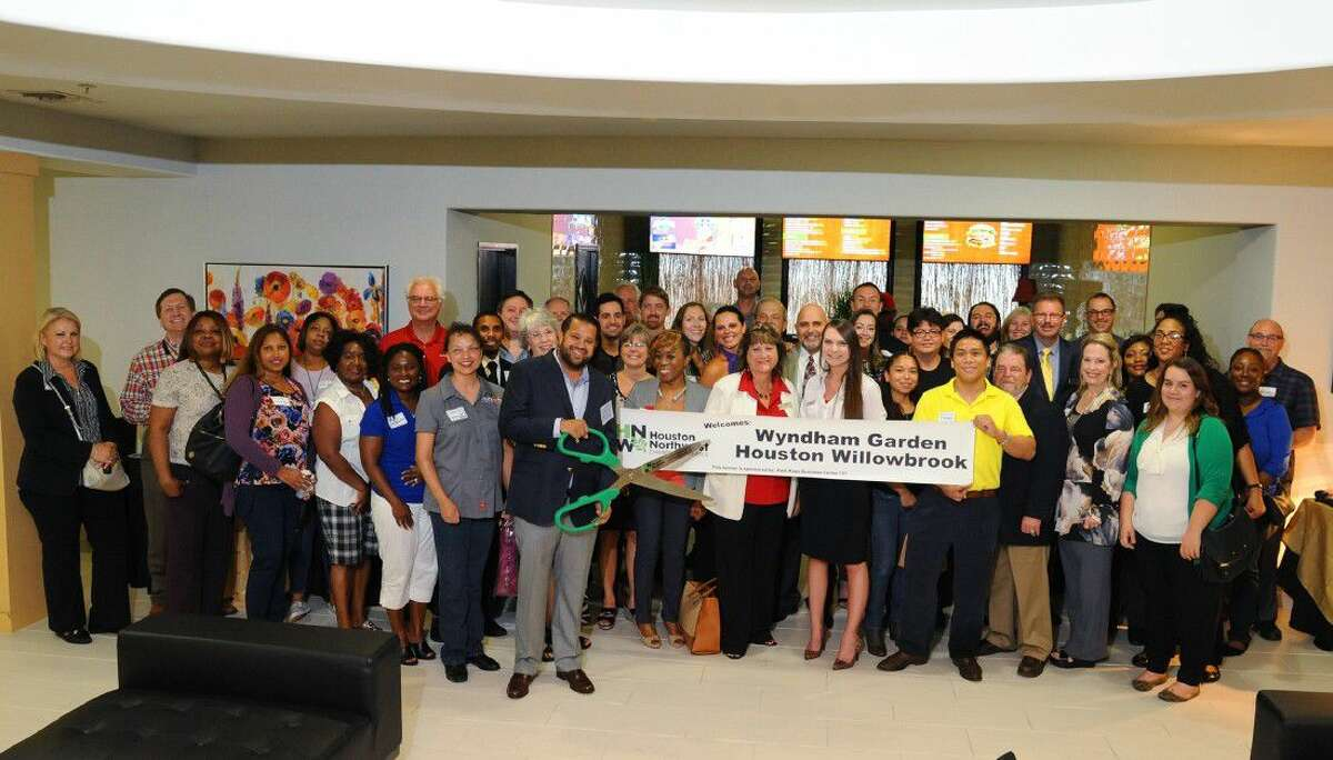 Hotel staff and community members celebrate the ribbon cutting at the grand opening of the Wyndham Garden Houston Willowbrook on Wednesday, Aug. 17.