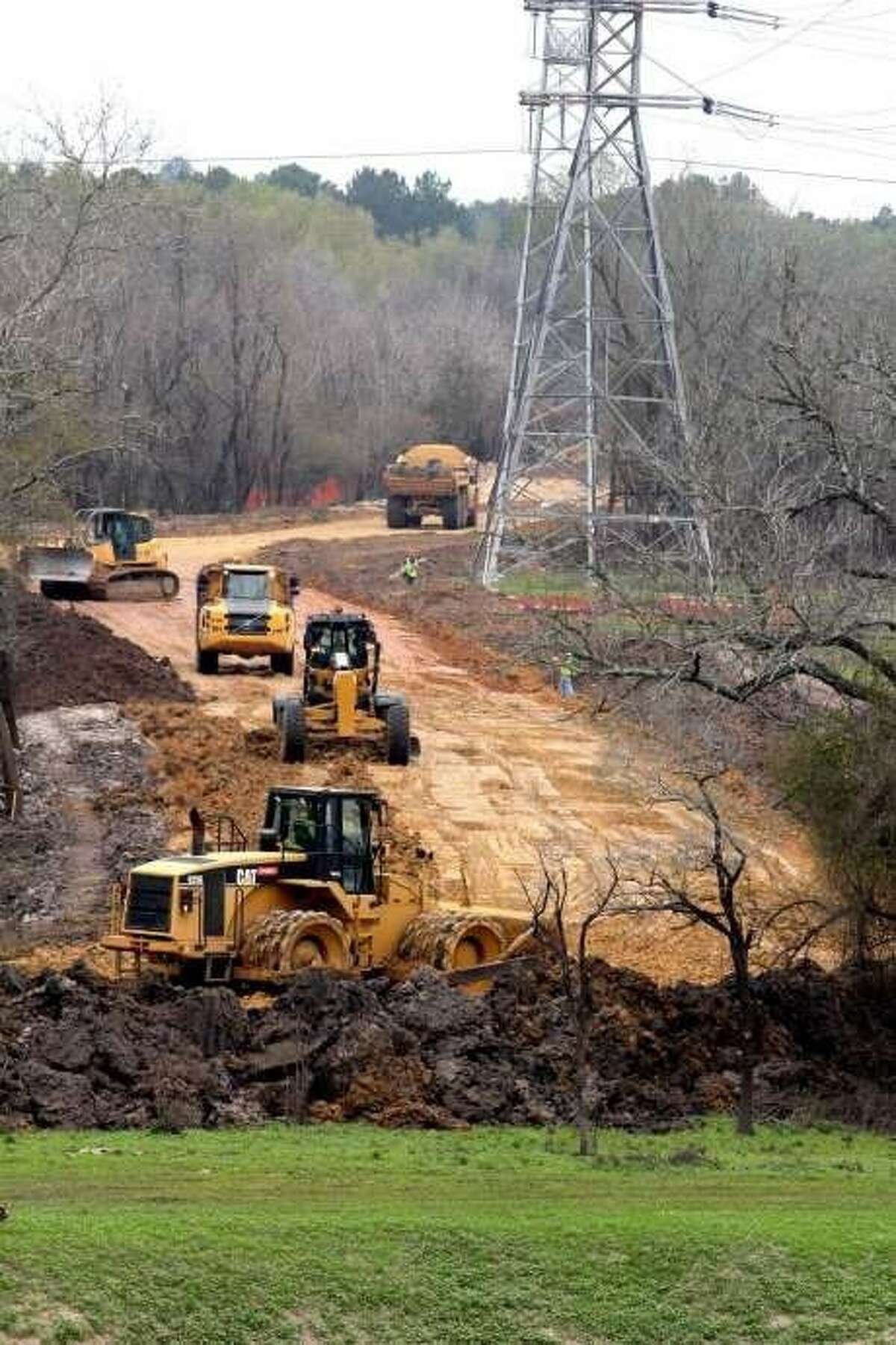Contractors for Granite Construction Co. prepare construction haul roads in May for the renovations to the Addicks and Barker dams.