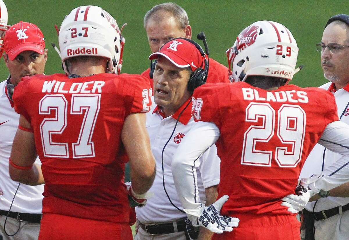 Katy Coach Gary Joseph talks to players on the sideline during a game last season. A video of coach Joseph's interview can be found by looking up Houston Community Newspapers on YouTube.