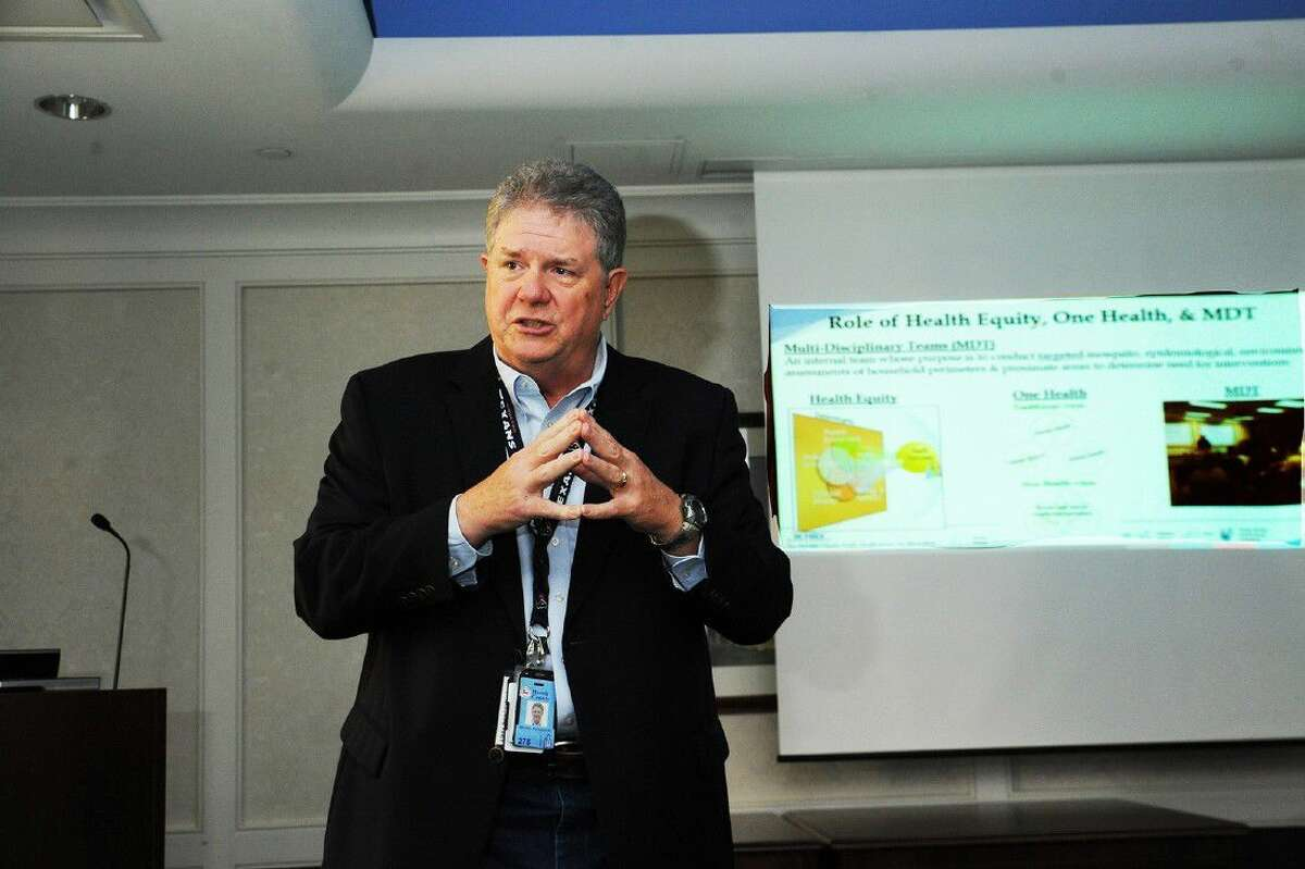 Mac McClendon, director of the Harris County Office of Public Health and Preparedness and Response, speaks at a luncheon.