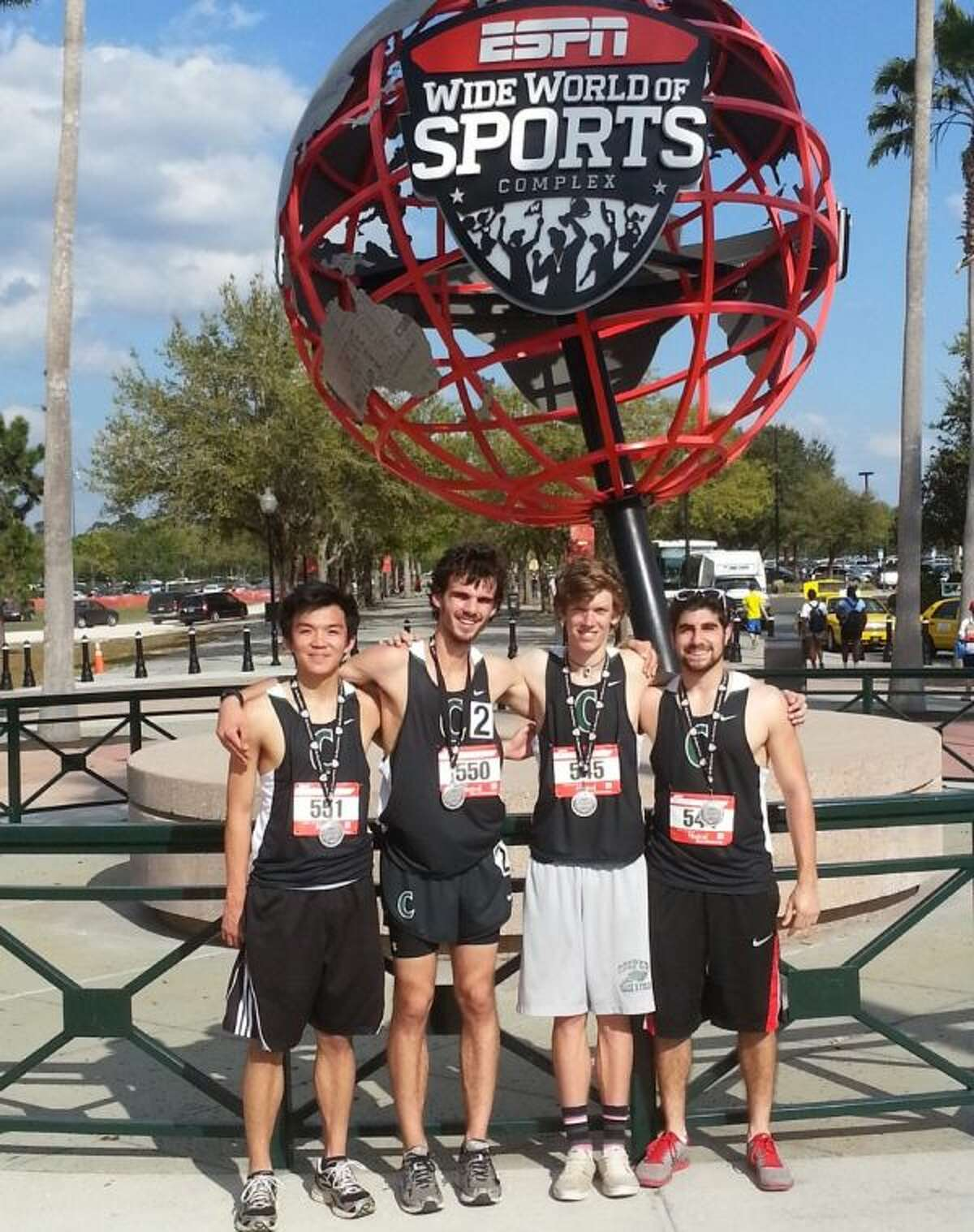 John Cooper athletes (from left) Derek Tam, Jacob Stelter, Cody Bohan and Rami Asi placed second in the distance medley relay at the Walt Disney World Open in Florida.