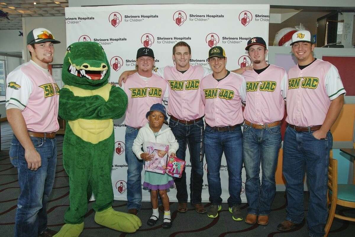 The San Jacinto College baseball team recently went to Shriners Hospital to visit with patients. Pictured, from left, visiting with 9-year old Lyzania, were: Tyler Newcomb, Kyneil Walwyn (mascot), Brett Wright, Austin Homan, Jorge Fernandez, Max Wood, and Seth Mullis. Photo credit: Dustin T. Johnson, public relations specialist, Shriners Hospital for Children Galveston.