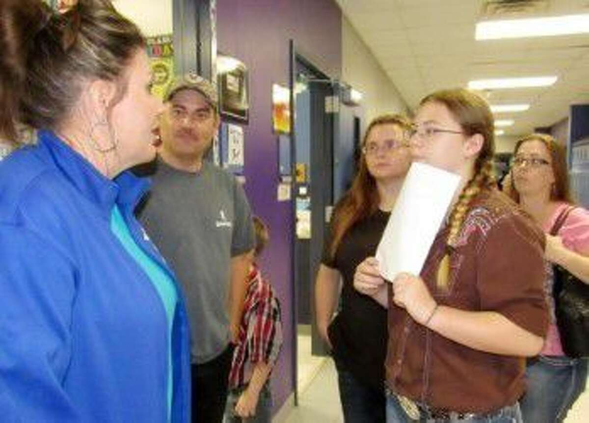 At Needville Junior High orientation on Aug. 17, eighth-grade science teacher Amanda Frankum welcomes new student Colleen Augustine. From left are Frankum and the Augustine family, Sam, Christi, Colleen and Melissa.
