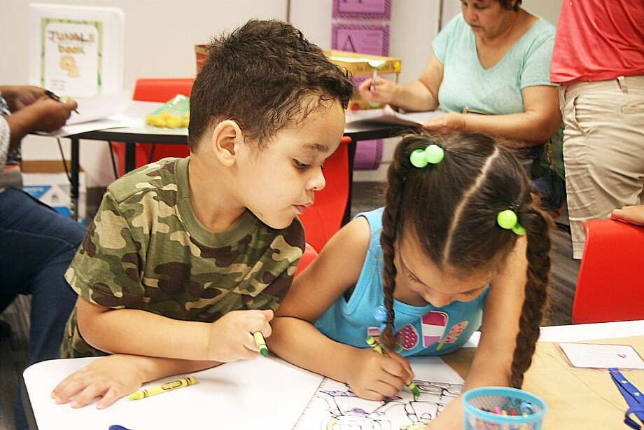 Sharon Tate's two children, Mathew (pre-K) and Allana (kindergarten), couldn't wait to break out their crayons and start coloring. Allana will attend Mr. Miller's kindergarten class. Miller has been teaching for 19 years and this is her first at Richter. Photo: Unknown