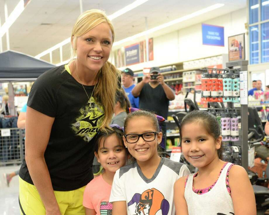 Legendary softball pitcher Jennie Finch greets fans Daniela De La Torre, Gabriela Lugo, and Lily De La Torre (L-R) at Academy Sports + Outdoors on August 27, 2016 in Sugar Land, TX. View this and additional photos at HCNPics.com. Photo: Craig Moseley