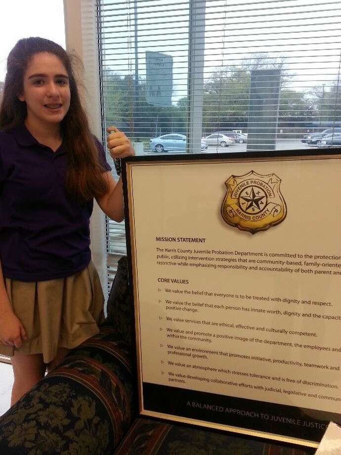 Lanier student earns community service award for library project at melony davis an eighth grade student at lanier middle school has earned the girl ccuart Choice Image