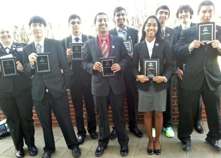 Pictured are (from left) Dawson High School students advancing to the state DECA conference: Brittany Sams, Jason Luong, Akshat Kumar, Karun Salvady, Prathik Patel, Rachel Daniel, Rajiv Patel, Nicolas Jeffress and Jacob Breaux. Photo: Courtesy Pearland ISD