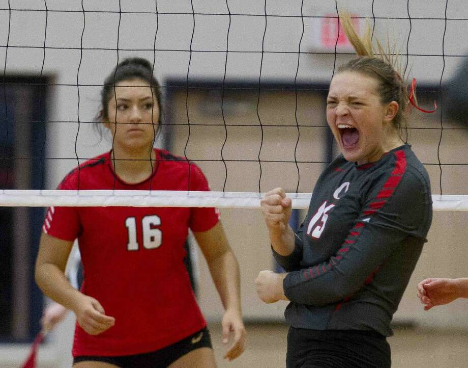 Oak Ridge middle blocker Hailey Lohnes (15) celebrates a point during the first set of a non-district high school volleyball match Tuesday, Aug. 30, 2016, at Oak Ridge High School. Oak Ridge swept Tomball 3-0.