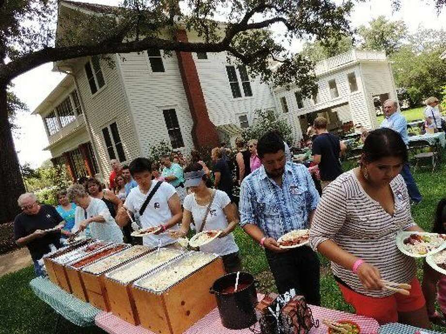 Chef Nick Castleberg's signature barbecue lunches under 200-year-old oak trees in the yard of the 1930s George home draw a crowd to the George Ranch Historical Park. Last year, pictured above, was no exception. Photo: George Ranch Historical Park
