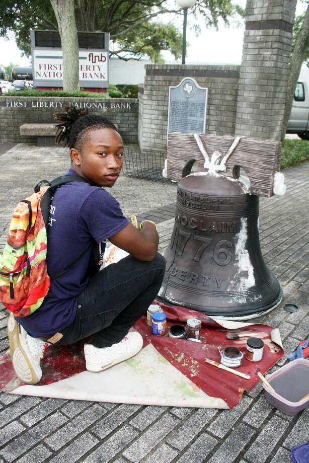 Liberty High School graduate Noah Holden spent his Saturday morning and afternoon leaving his legacy with his artistic talents. Holden was commissioned to paint the Liberty Bell in front of the First Liberty National Bank.