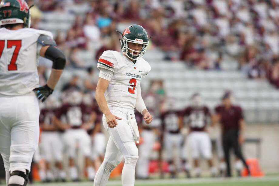 The Woodlands quarterback Eric Schmid looks to the sideline during the Highlanders 23-20 win over Cy Fair last Friday.