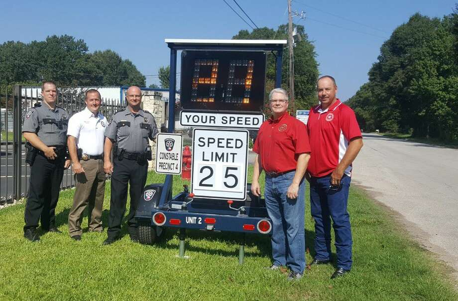 Representatives from the East Montgomery County Improvement District and Montgomery County Constable's Office Precinct 4 pose next to a new radar speed sign in front of the Montgomery County Commissioner's Office Precinct 4 Sept. 1.