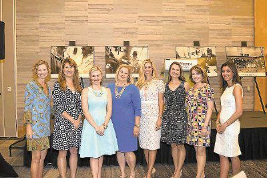 Kelly Hull (second from the right), 2016 Hometown Hero, is pictured with fellow committee members of Interfaith Community Clinic's Women Empowering Women.