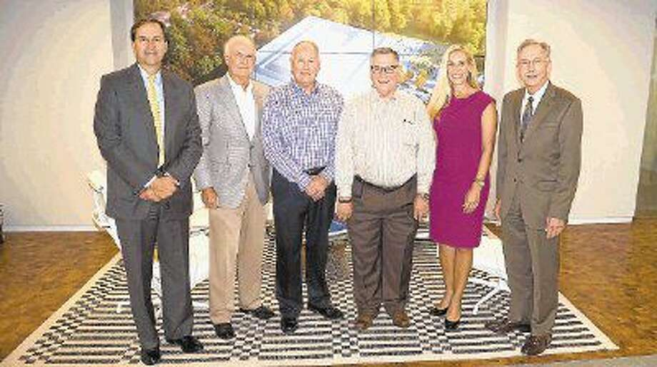 Bob Hibbetts (third from the right) has been named a 2016 Hometown Hero. From left to right are Paul Layne, executive vice president, Master Planned Communities, for The Howard Hughes Corporation; Alex Sutton, co-president of The Woodlands Development Company; Randy Davis, chief financial officer of The Woodlands Development Company; Missy Herndon, president and CEO of Interfaith of The Woodlands; and Tim Welbes, co-president of The Woodlands Development Company.
