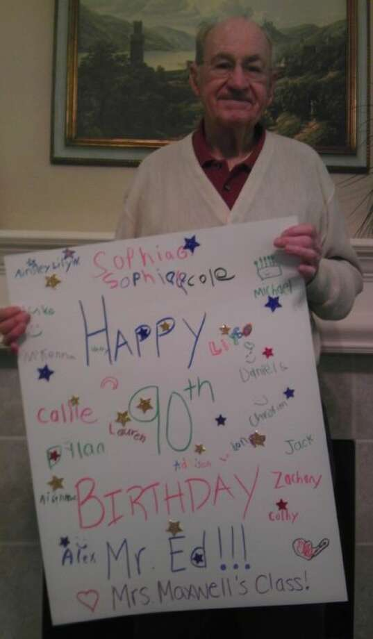 """Ed Thorney, a volunteer of more than 13 years with the Conroe Independent School District's Buckalew Elementary, holds a poster signed by students and teachers celebrating his 90th birthday. Thorney, known as """"Mr. Ed"""" to most students and teachers, received handmade birthday cards, gifts and a binder full of well-wishes and greetings from school staff and students. Photo: Jonathan Garris"""
