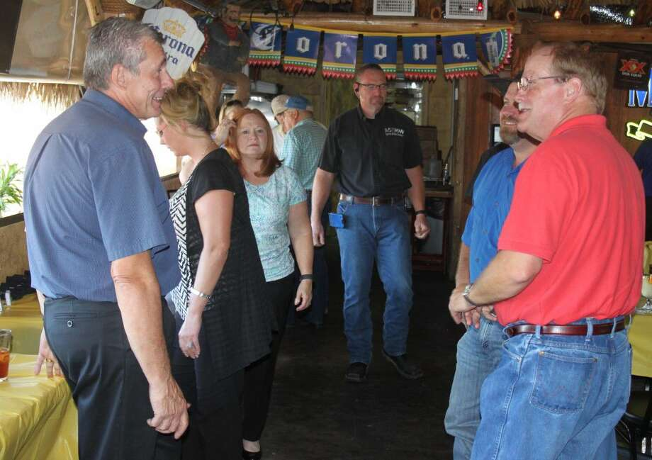 New members of the Greater Cleveland Chamber of Commerce introduce themselves to longtime members at the After-Hours event on Aug. 30 at Pueblo Viejo. Photo: Jacob McAdams