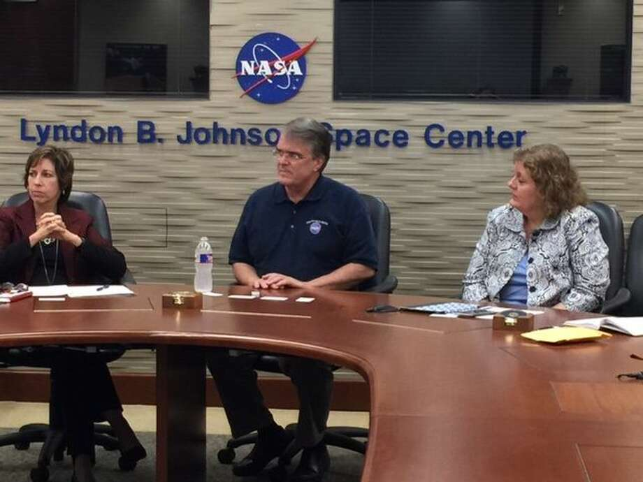 U.S. Rep. John Culberson, center, listens during a presentation Tuesday at Johnson Space Center in Houston.