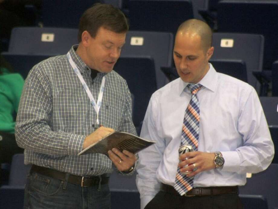 The Herrington Patriot Center public address announcer goes over the San Jac players' names with head coach Scott R. Gernander prior to Thursday night's quarterfinal contest on the UT-Tyler campus. Photo: Robert Avery