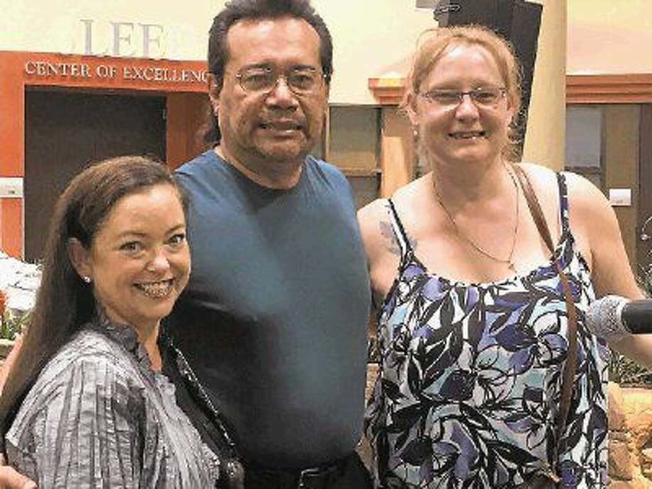 Kilee Northrup, Nurse at Kingwood Medical Center, left, and patient, Atilio Zelaya and wife, Andrea Shannon, during the DAISY Award presentation.