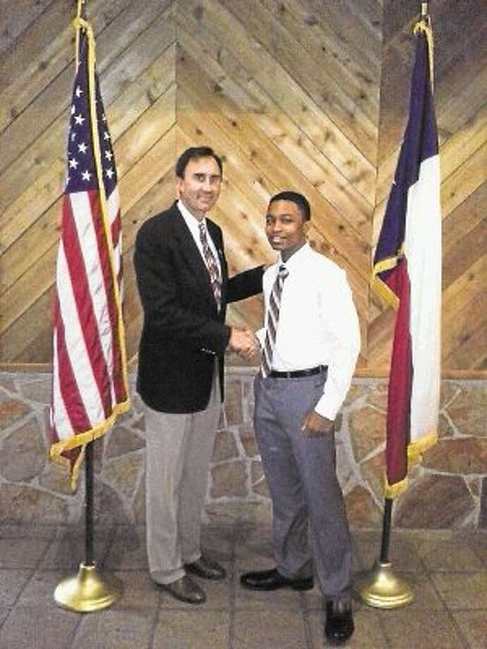 U.S. Congressman Pete Olson congratulates Dawson High School student Solomon D. Conner II on being chosen to participate in the 2013-14 Congressional Youth Advisory Committee. Photo: Submitted Photo / @WireImgId=2678604
