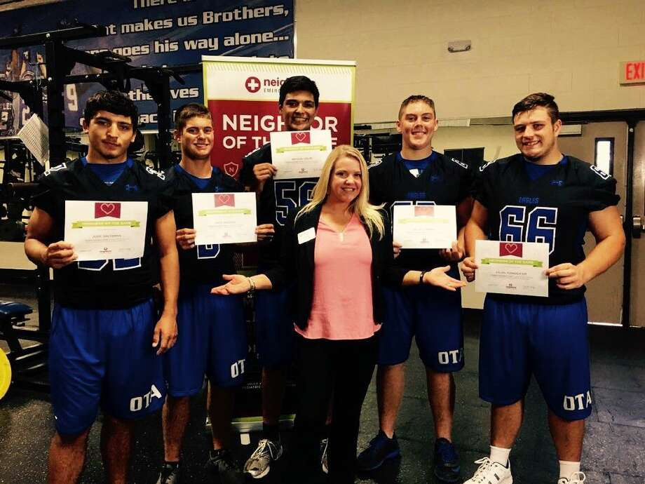 New Caney High School student athletes pose after receiving Neighbor of the Game certificates from Neighbors Emergency Center in Porter. From left to right: Josh Saltman, Matt Bridges, Bryson Grupe, Neighbors Emergency Center Porter Marketing Liaison Clair King, Jacob Carroll and Dylan Poindexter.