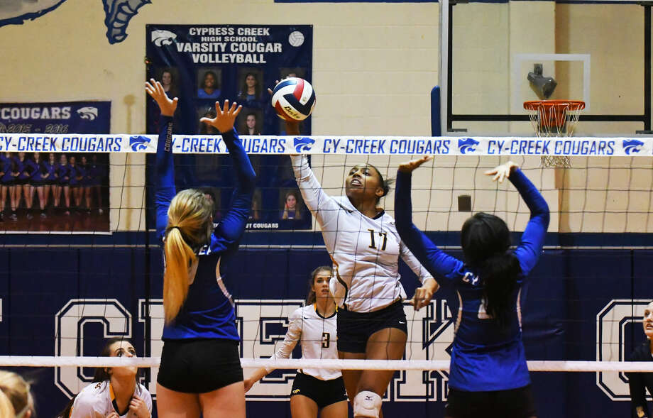 Cypress Ranch junior Kayla Benton notches a kill against the Cypress Creek font line in Tuesdays district match. Benton tied with teammate Hailey Peters for kill leader with 11. Photo: Tony Gaines