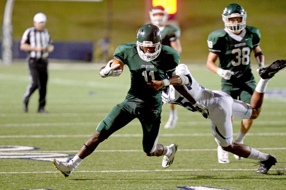 Wide receiver Jaetavian Toles (11) of Stratford carries the ball in the third quarter of a high school football game between Stratford and Elsik on September 1, 2016 at Tully Stadium, Houston, TX. Photo: Craig Moseley