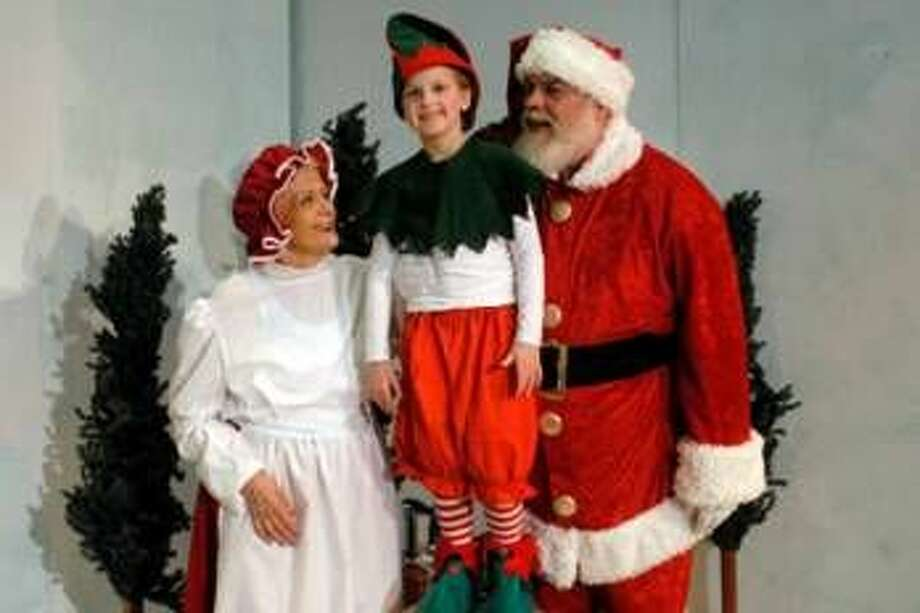 Mrs. Claus (Roz Turner), Alvin the Elf (Anabel Precht) and Santa (Mike McDermott) get ready for Christmas.
