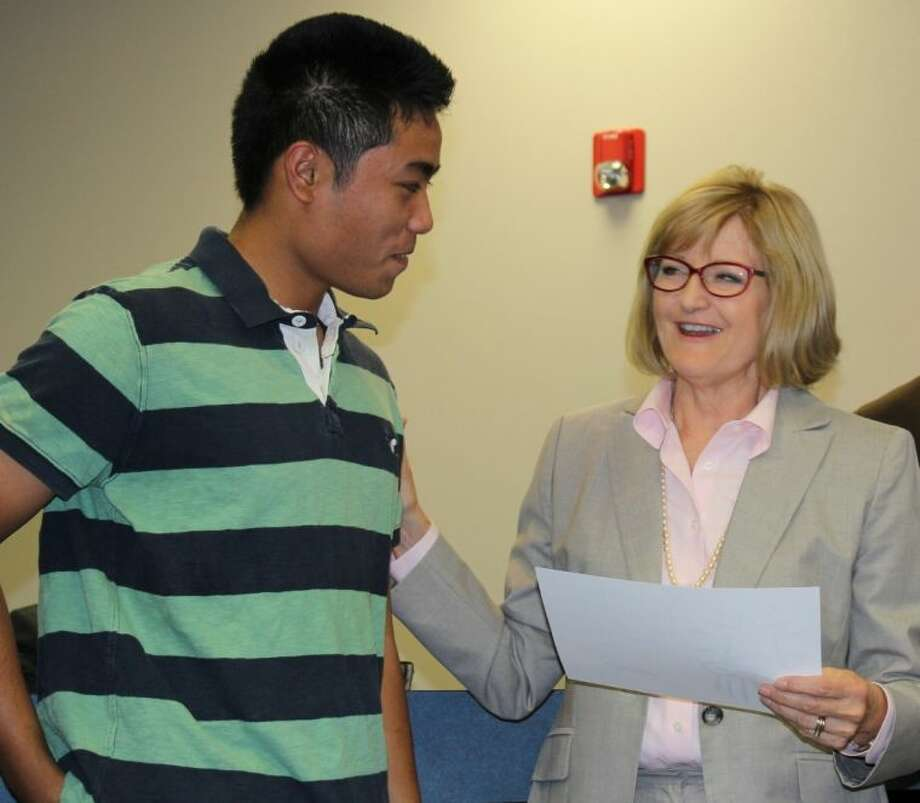 "One of Dr. Rebecca Hillenburg's favorite things about being on the FISD Board of Trustees is the ""Celebration of Excellence,"" recognizing student accomplishments, here with 2013 High School Valedictorian Andrew Mai. Photo: Courtesy Friendswood ISD"